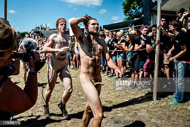 People take part in the 'Naked Run' on July 6 2013 at the Roskilde music festival in Roskilde Denmark to win a free ticket for upcoming festivals AFP...