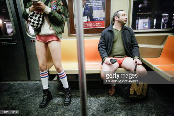People take part in the No Pants Subway Ride braving freezing temperatures on January 7 2018 in New York City The annual event in which participants...