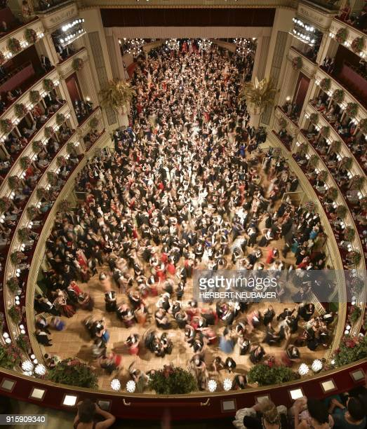 People take part in the opening ceremony of the the Vienna Opera Ball on February 8 in Vienna / AFP PHOTO / APA / HERBERT NEUBAUER / Austria OUT
