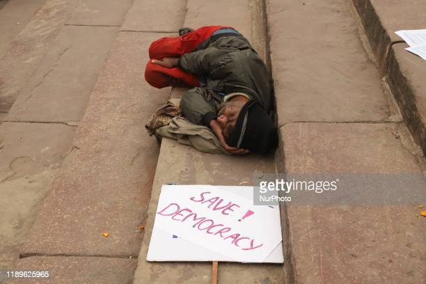 People take part in the protests against the Citizenship Amendment Act on the stairs of Jama Masjid in New Delhi on 19 December 2019 People march in...
