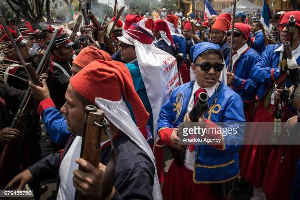 People take part in the representation of the Battle of Puebla Mexico's victory over France in 1862 during its anniversary celebration in Mexico City...
