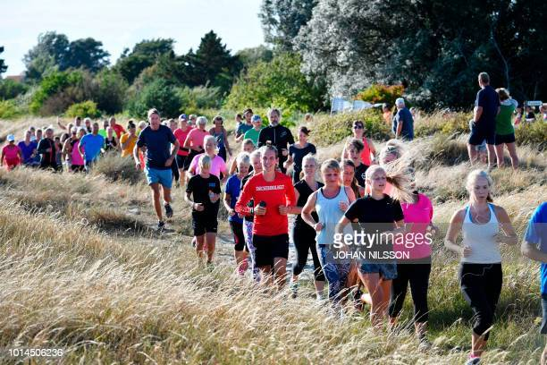 People take part in the Run for Kim charity run in memorial of murdered Swedish journalist Kim Wall on August 10 2018 in Trelleborg Sweden Over 570...