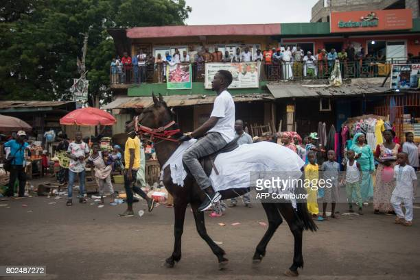 People take part in the Sallah festival which ends celebrations of Eid alFitrat on June 26 2017 in Nima the most important muslim neighborhood in...