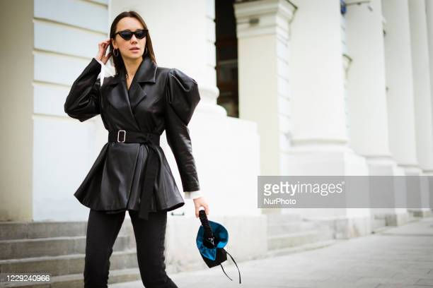 People take part in the Street Style Mercedes Benz-Fashion Week Russia Spring/Summer 2021 on October 23, 2020 in Moscow, Russia.