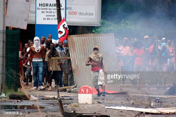 People take part in violent clashes between demonstrators and police on September 28 in Mamoudzou capital of the French overseas island of Mayotte in...