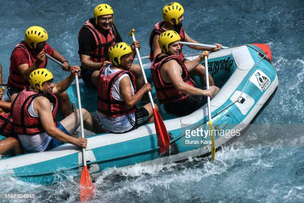 People take part in white water rafting on the river in Koprulu Canyon on August 18 2019 in Manavgat Turkey Turkey's resort towns saw a 100 percent...