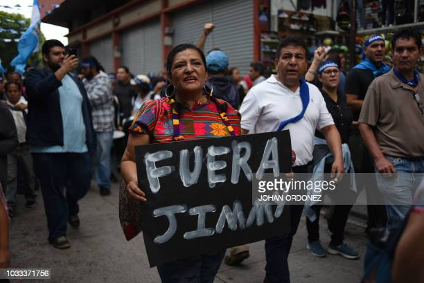 People take part of a demo to demand the resignation of Guatemalan President Jimmy Morales and the renewal of the mandate of an anticorruption...