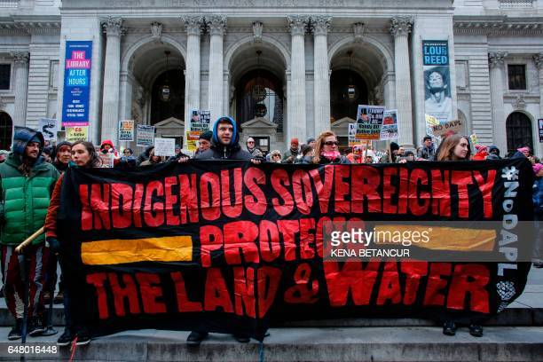 People take part of a protest against the planned Dakota Access Pipeline in North Dakota on March 04 2017 in New York / AFP PHOTO / KENA BETANCUR