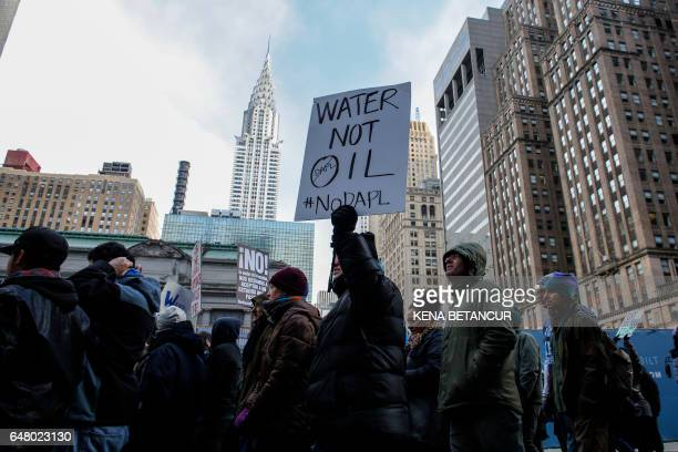 TOPSHOT People take part of a protest against the planned Dakota Access Pipeline in North Dakota on March 04 2017 in New York / AFP PHOTO / KENA...