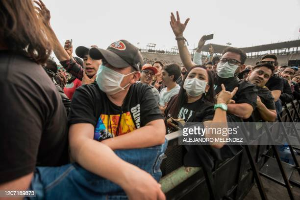 People take part of the 'Vive Latino' music festival wearing masks as a preventive measure in the face of the global COVID19 coronavirus pandemic at...