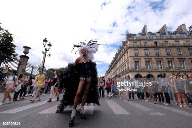 People take part the Paris Gay Pride Parade or known as Marche des Fiertés LGBT in France as they march through a street on June 24 2017 in Paris...