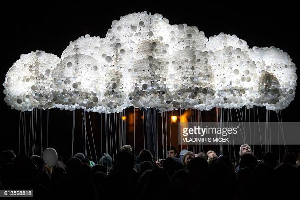 People take part to an interactive art installation 'Cloud' created from 6000 lightbulbs by Canadian artists Caitlind RC Brown Wayne Garrett during...