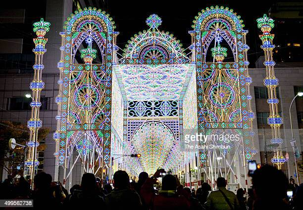 People take photographs during the Kobe Luminarie 2015 test illumination on December 1 2015 in Kobe Hyogo Japan The annual illumination to...