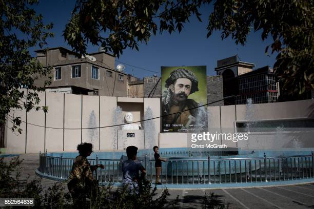 People take photographs in fornt of a portrait of Kurdish leadern Sheix Mohmood ahead of the referendum for independence of Kurdistan on September 23...