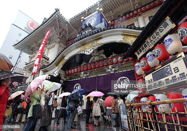 People take photographs in front of Kabukiza theater on April 28 2010 in Tokyo Japan