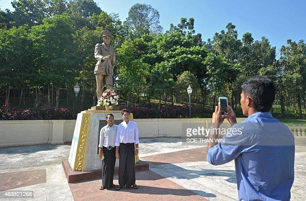 People take photographs in front of the late General Aung San statue during to mark the 100th birthday of independence hero Aung San in Yangon on...