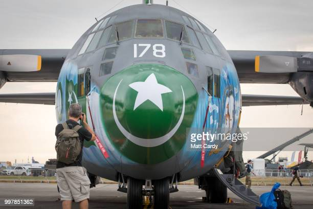 People take photographs of a Pakistan air Force C-130E Hercules at the Royal International Air Tattoo at RAF Fairford on July 13, 2018 in...