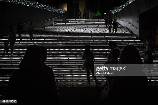 People take photographs of a staircase decorated with lights at Odaiba on May 31 2014 in Tokyo Japan Odaiba is a large artificial island on Tokyo Bay...