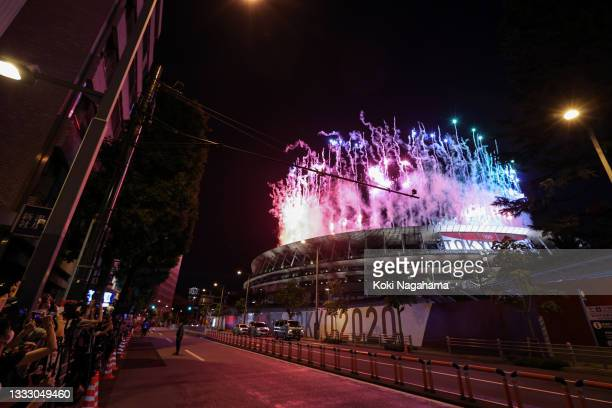 People take photographs of fireworks during the Closing Ceremony of the Tokyo 2020 Olympic Games at Olympic Stadium on August 08, 2021 in Tokyo,...