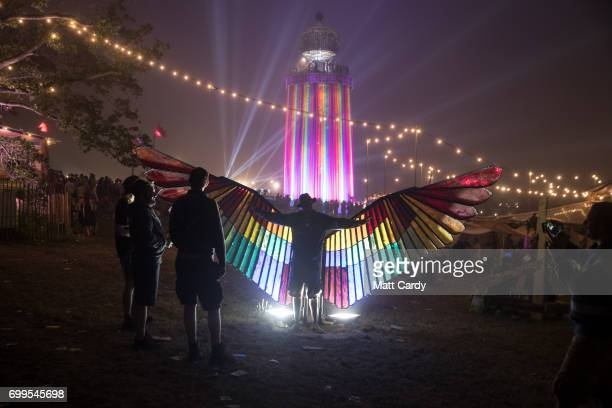 People take photographs of one another at the end of the first day at the Glastonbury Festival at Worthy Farm in Pilton on June 21 2017 near...
