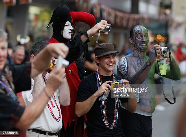 People take photographs of others participating in the Fantasy Fest Masquerade March October 27 2007 in Key West Florida The 10day costuming and...
