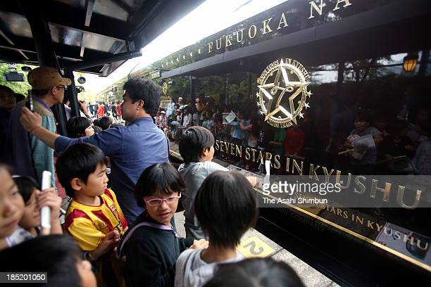 people take photographs of the JR Kyushu's luxury sleeper train 'Nanatsuboshi ' at Yufuin Station on October 15 2013 in Yufu Oita Japan When shared...