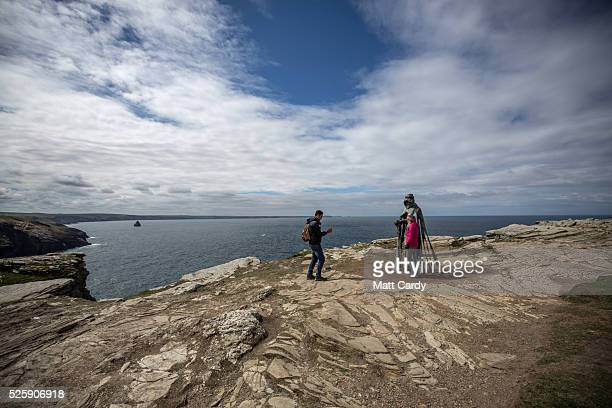 People take photographs of the new 'Gallos' sculpture that has been erected at Tintagel Castle in Tintagel on April 28 2016 in Cornwall England The...