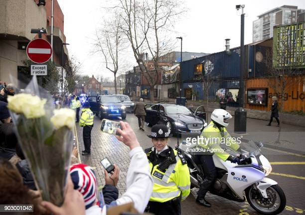 People take photos as Prince Harry and his fiance Meghan Markle arrive to Pop Brixton to see the broadcaster's work supporting young people through...