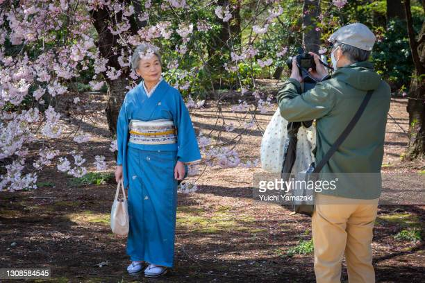 People take photos during the cherry blossom bloom on March 23, 2021 in Tokyo, Japan. On March 14, the Japan Meteorological Corporation declared the...