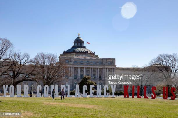 People take photos of the March For Our Lives students place gun violence prevention art on the US Capitol grounds on March 26 2019 in Washington DC...