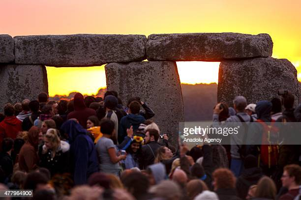 People take photos of the Summer Solstice sunrise at Stonehenge on June 21 2015 in Wiltshire England Thousands of revellers gather at the 5000 year...