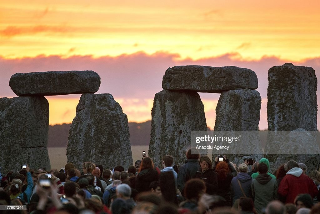 People take photos of the Summer Solstice sunrise at Stonehenge on June 21, 2015 in Wiltshire, England. Thousands of revellers gather at the 5,000 year old stone circle in Wiltshire to see the sunrise on the Summer Solstice dawn. The solstice sunrise marks the longest day of the year in the Northern Hemisphere.