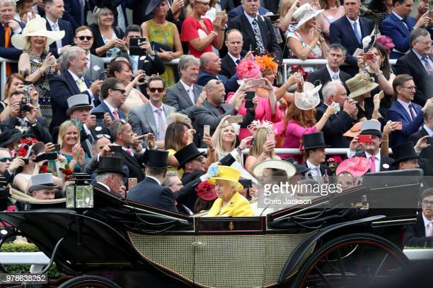 People take photos with their phones as Lord Vestey Prince Andrew Duke of York Queen Elizabeth II and Princess Anne Princess Royal arrive by carriage...