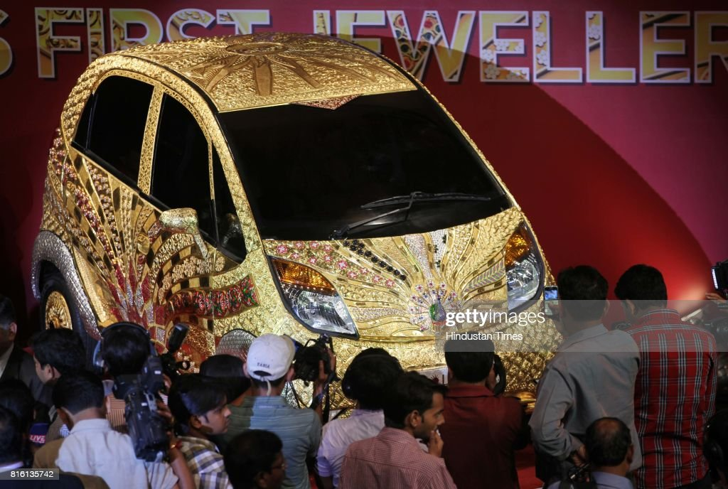 People take picture at the launch of Goldplus Nano Car at NCPA at Nariman Point on Monday.Goldplus Nano, world's first ever pure gold jewellery car.Goldplus car is tribute to thw nation acknowledging 5000 years of Indian jewellery making.