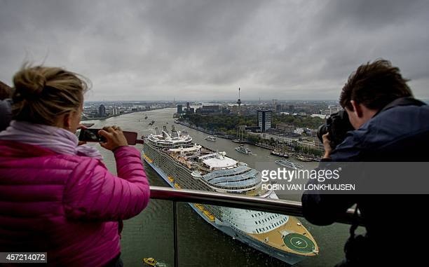 People take picture on October 14 2014 of the world's largest cruise ship 'Oasis of the Seas' leaving the Rotterdam harbour The owners had to pay...