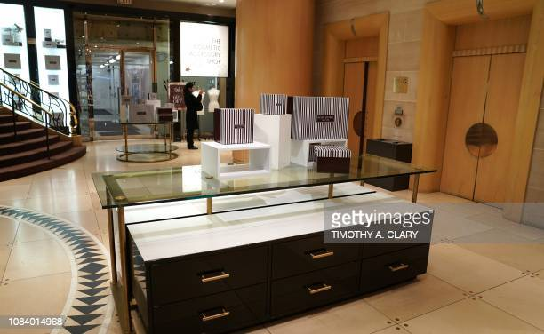 People take pictures at luxury retailer Henri Bendel flagship store on 5th Avenue January 17 2019 on the last day of business for the iconic store...