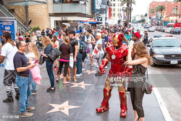 People take pictures at the Hollywood Walk of Fame in Hollywood Los Angeles California