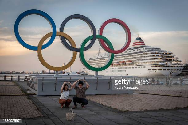 People take pictures in front of Olympics rings on July 22, 2021 in Yokohama, Japan. Olympics opening ceremony director, Kentaro Kobayashi, has been...