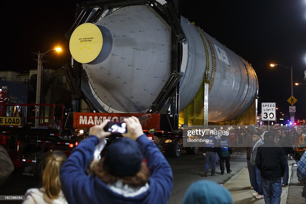 People take pictures of a steel coke drum on a trailer manufactured by Mammoet Salvage BV as it travels along the Pacific Coast Highway between Redondo Beach and El Segundo, California, U.S., on Wednesday, Feb. 20, 2013. The drum, which measures over 100 feet long and weigh 500,000 pounds is one of six scheduled to be delivered to Chevron Corp.'s refinery in El Segundo. Photographer: Patrick Fallon/Bloomberg via Getty Images