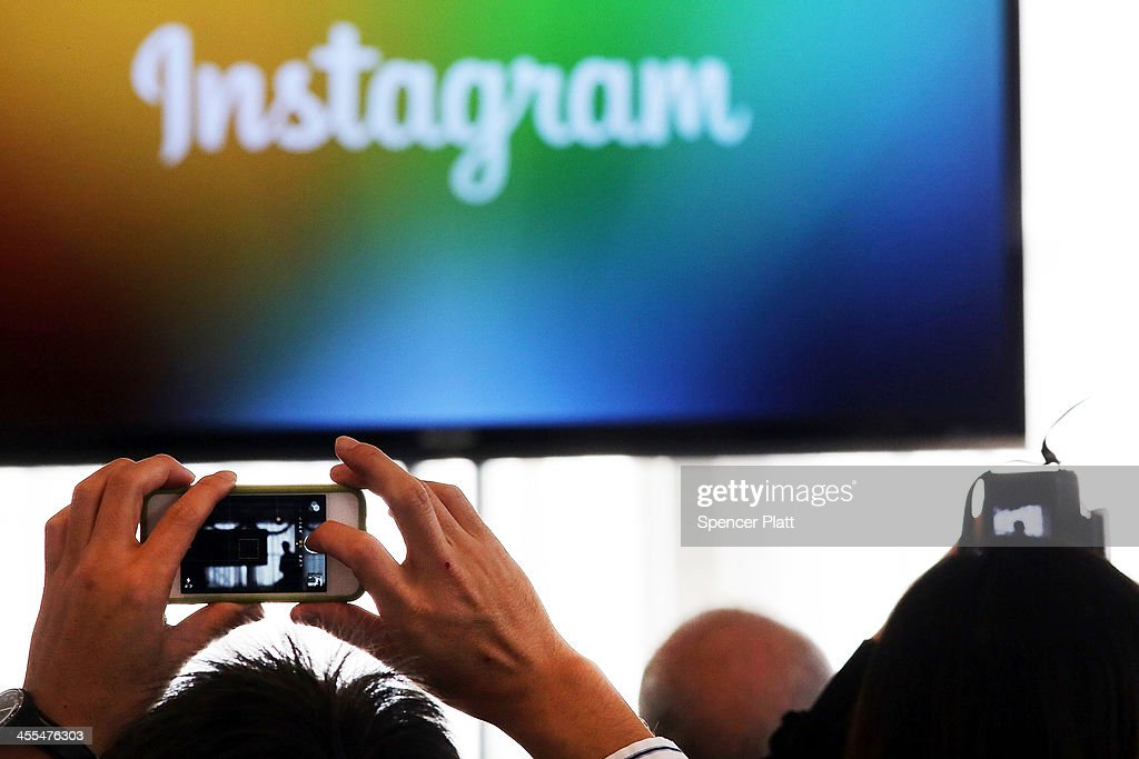 People take pictures of Instagram CEO Kevin Systrom as he speaks at a news conference where he intruduced Instagram Direct on December 12, 2013 in New York City. Instagram Direct will allow users of the photo-based social networking site to share images with specific friends or followers. Instagram Direct will let you send photos and videos directly to up to 15 friends at once.