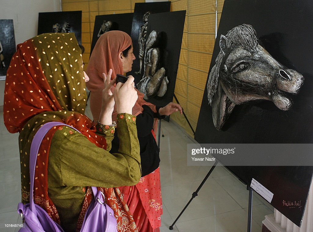 People take pictures of sculptures by Shehla Arif, a participant and student of psychology who made them out of materials like newspapers, silver foil, and packing tapes during an exhibition on June 5, 2010 in Srinagar, the summer capital of Indian administered Kashmir. The quest for the finest artist of Kashmir, famous for being the axis of relations between India and Pakistan, a 'nuclear flashpoint' that could spark an unthinkable war in South Asia, began today at the Institute of Hotel Management in Srinagar. The exhibition included diverse forms of art work, with 200 displays in the category of Canvas painting, Pencil and Charcoal Art , Fabric painting, Glass painting, Photography, Art from junk and Calligraphy. Forty five artists from different districts participated, including the guest artists like Shaiqa Mohi, Shafi Chaman, Rakesh Kumar, Iftikhar Jaffar, Masood Hussain and many others.