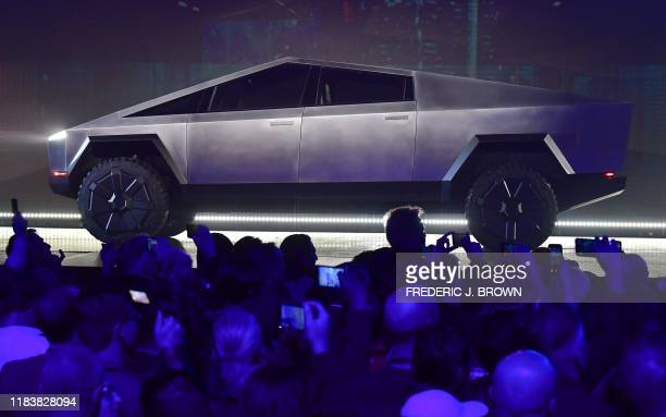 People take pictures of the newly unveiled allelectric batterypowered Tesla's Cybertruck at Tesla Design Center in Hawthorne California on November...