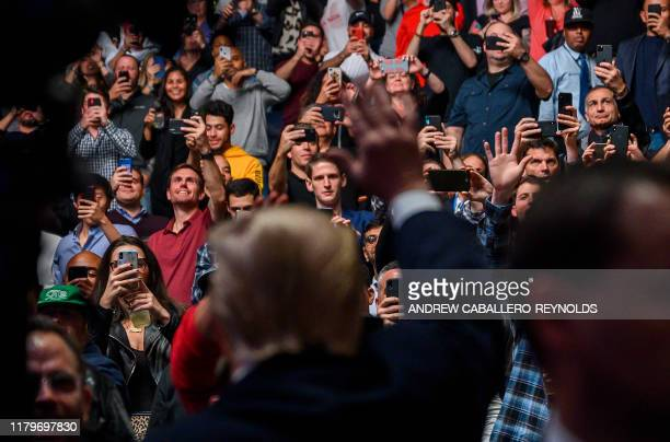 People take pictures of US President Donald Trump as he arrives to watch the Ultimate Fighting Championship at Madison Square Garden in New York City...