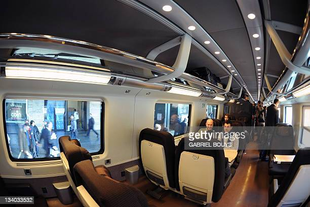 People take place in the first class of a Freccia Rossa highspeed train at Rome's Termini station on 24 November 2011 AFP PHOTO / GABRIEL BOUYS
