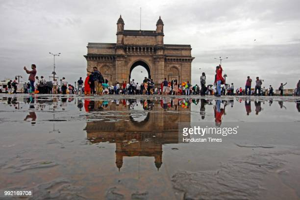 People take selfie and chill while it rains at Gateway of India on July 4 2018 in Mumbai India Heavy rains made a comeback in Mumbai causing...