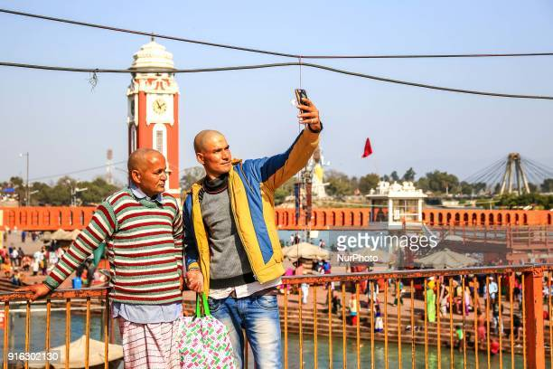 People take selfie at Har ki Pauri in Haridwar Uttrakhand India on 8th Feb 2018According to hindu culture Har ki Pauri one of the famous ghat and...