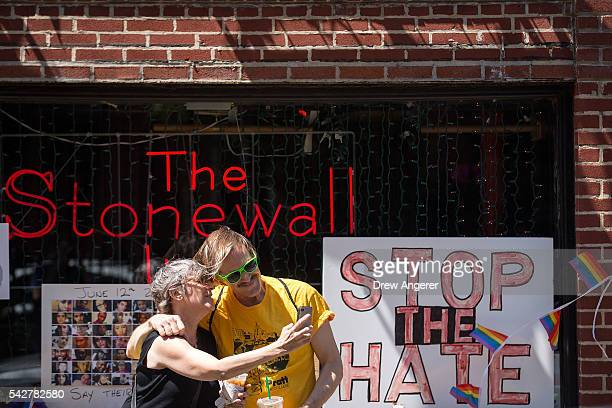 People take 'selfie' photographs in front of the Stonewall Inn on June 24 2016 in New York City President Barack Obama designated Stonewall Inn and...