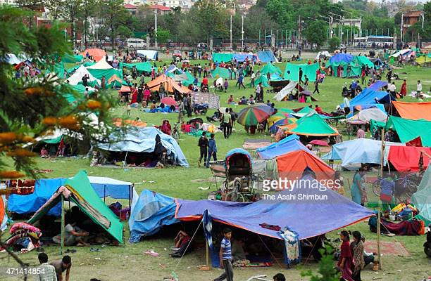 People take shelter at a park on April 27, 2015 in Kathmandu, Nepal. A major 7.8 earthquake hit Kathmandu mid-day on Saturday, and was followed by...