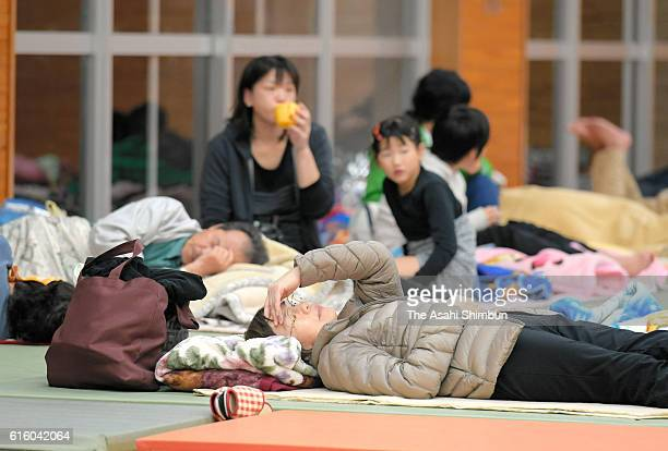 People take shelter at an evacuation center after the magnitude 6.6 earthquake hit the area on October 21, 2016 in Hokuei, Tottori, Japan. A quake...