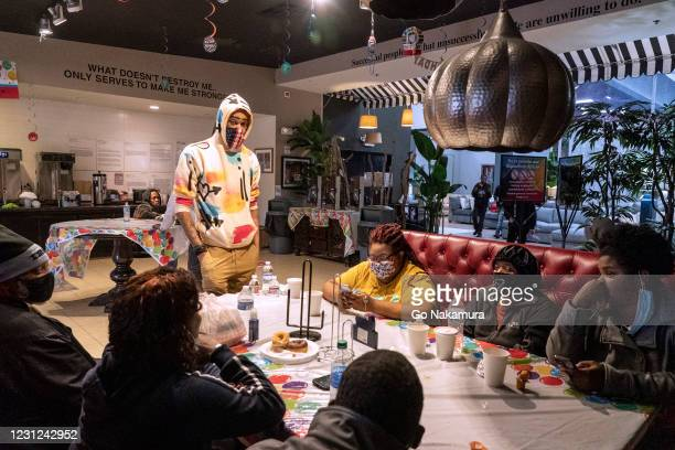 People take shelter at Gallery Furniture store which opened its door and transformed into a warming station after winter weather caused electricity...